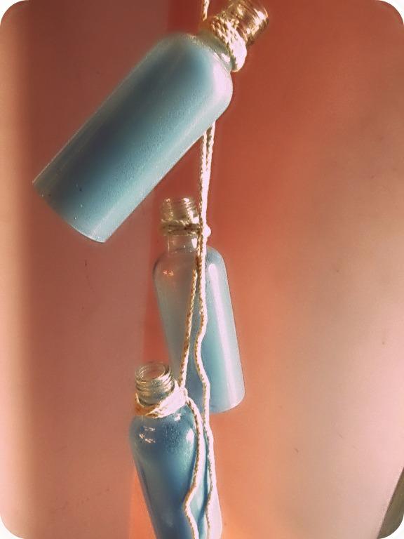 Diy beachy wine bottle chandelier trumatter for How to make a bottle chandelier